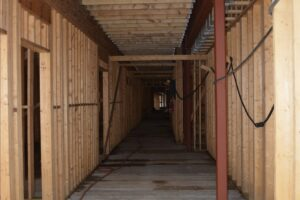 Corridor on first floor of residential units, looking east